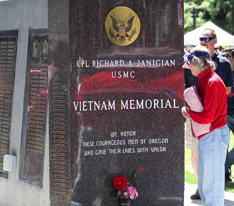 TIMES PHOTO: MILES VANCE - The Vietnam War veterans memorial once housed at the Beaverton Elks Lodge has been relocated to Veterans Memorial Park in Beaverton, and was a focus of much interest during Monday's Memorial Day celebration.