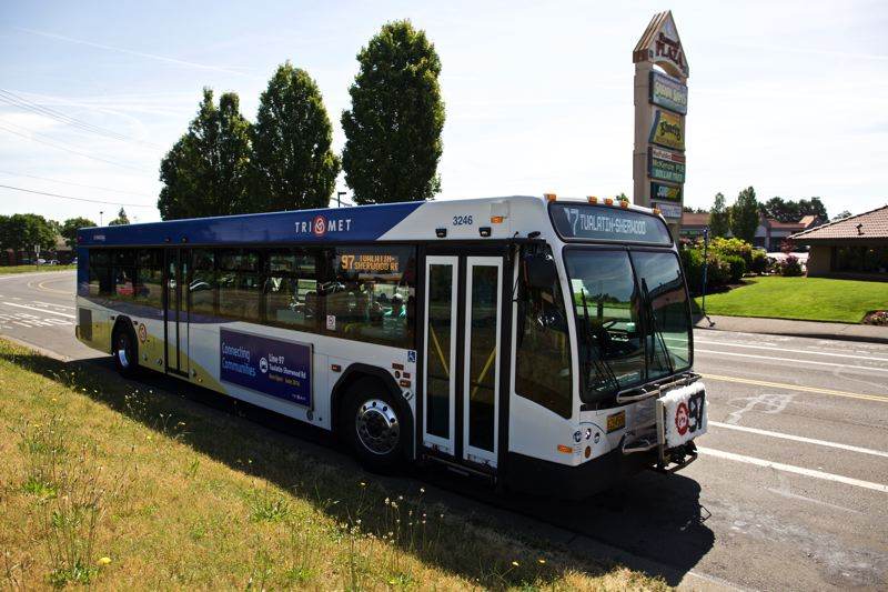 TIMES PHOTO: JAIME VALDEZ - A TriMet bus arrives at the Sherwood Plaza during the 'first ride' for line 97, which officially begins service next Monday.