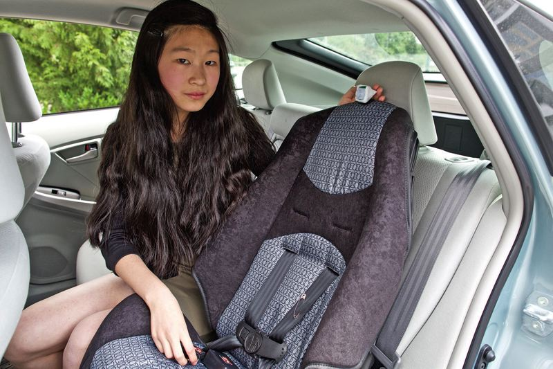 TIMES PHOTO: JAIME VALDEZ - What sets apart Jessica Yus safety feature on a baby car seat are two sensors that  alert parents that their child is left alone in a vehicle through a key fob.