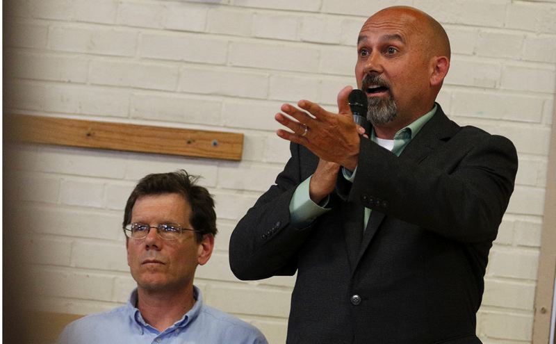 TRIBUNE PHOTO: JONATHAN HOUSE - Portland Public Schools Chief Operating Officer Tony Magliano at a Wednesday evening community meeting responds to questions about lead levels in the water. Board Chair Tom Koehler is also pictured.