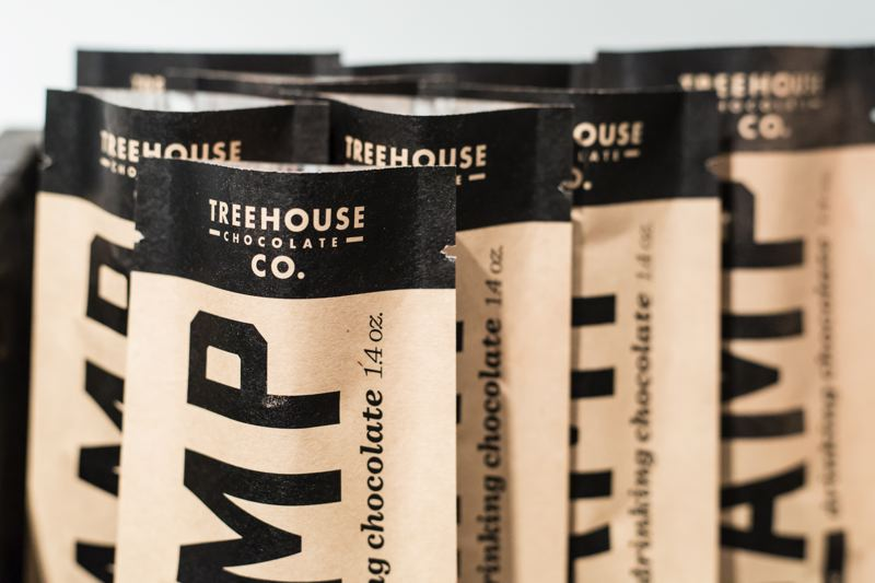 PAMPLIN MEDIA GROUP: JONATHAN HOUSE - Bags of Treehouse Chocolate wait to be sealed during production. The cacao comes from organic farmer-owned cooperatives in northern Peru.