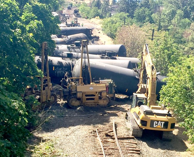 COURTESY PHOTO: ODOT - Crews began working on the damaged rail cars that derailed Friday, June 3, near the Columbia River Gorge town of Mosier.