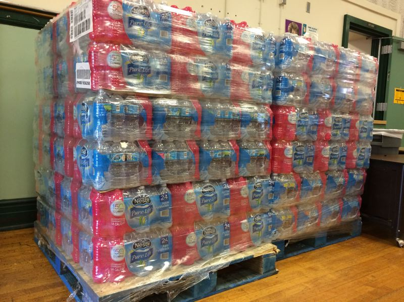 SUBMITTED PHOTO - Palates of water wait for students and staff at a school in Portland during uncertainty over lead levels in the water fixtures.