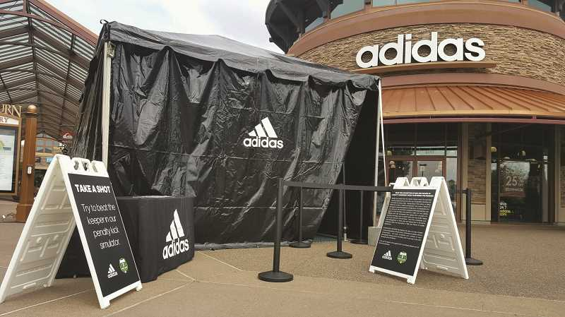 COURTESY PHOTO: WOODBURN PREMIUM OUTLETS - The Adidas store at the popular outlet mall celebrated its reopening over the Memorial Day weekend.