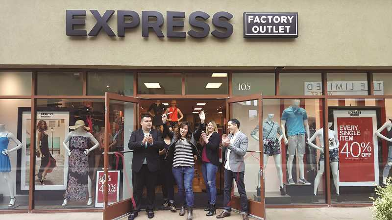 COURTESY PHOTO: WOODBURN PREMIUM OUTLETS - From left, co-manager Austin Hyde, sales associate Cheyanne Jackman-Bartolo, manager Megan Reed, sales lead Shannon Beber and district manager Adrian Noyer celebrate the opening of the new Express store at Woodburn Premium Outlets, following a May 26 ribbon cutting.