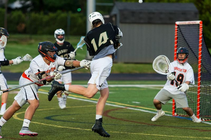 TIMES PHOTO: CHRIS OERTELL - Jesuit High attacker Sam Handley #14 takes a shot during the Boys Lacrosse State Championship game at Beaverton High School
