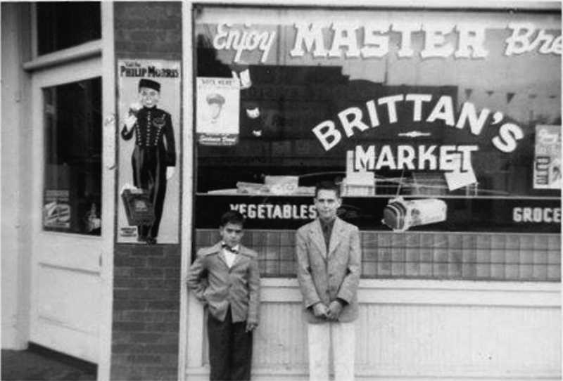 COURTESY PHOTO: KAY MCEWEN - Boys gather in front of Brittan's Market in Woodburn about 55 years ago.