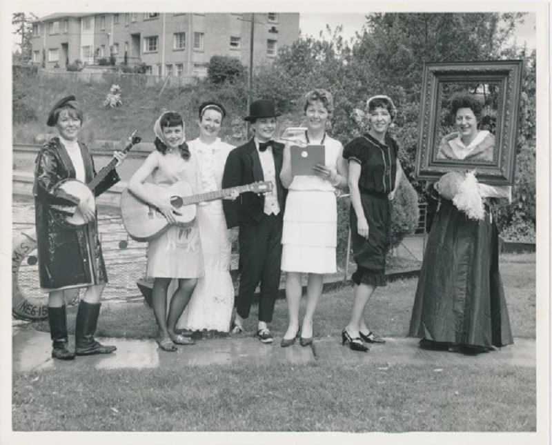 PHOTO COURTESY OF LAKE OSWEGO PUBLIC LIBRARY - Chamber of Commerce board members put on a show to advertise the 1965 festival. Most of the group is unidentified, but that's Shirley Gladsby at far left, June Kroft at far right and Deanne Clinkscales in the tuxedo.