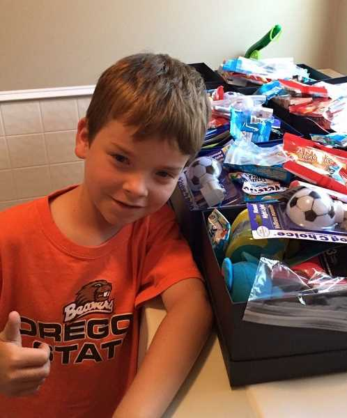 SUBMITTED PHOTO - Brayden collects items like toys and clothes for the foster children welcome boxes.