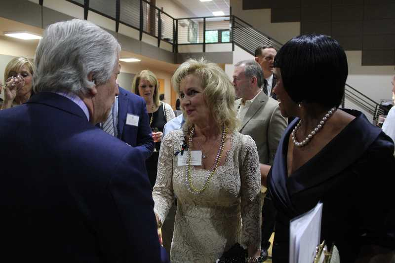 REVIEW PHOTO: KELSEY OHALLORAN - Park Academy founder Piper Park (left)) chats with TV celebrity Henry Winkler, while Head of School Paula Kinney beams.