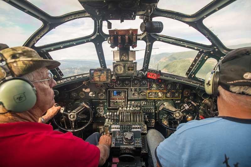 OUTLOOK PHOTO: JOSH KULLA - The view from the cockpit of the B-24 Liberator Witchcraft, which is owned and operated by the Collings Foundation. The plane stopped Wednesday at Troutdale Airport for a three-day visit that is open to the public. The plane is the last remaining airworthy example of its kind.