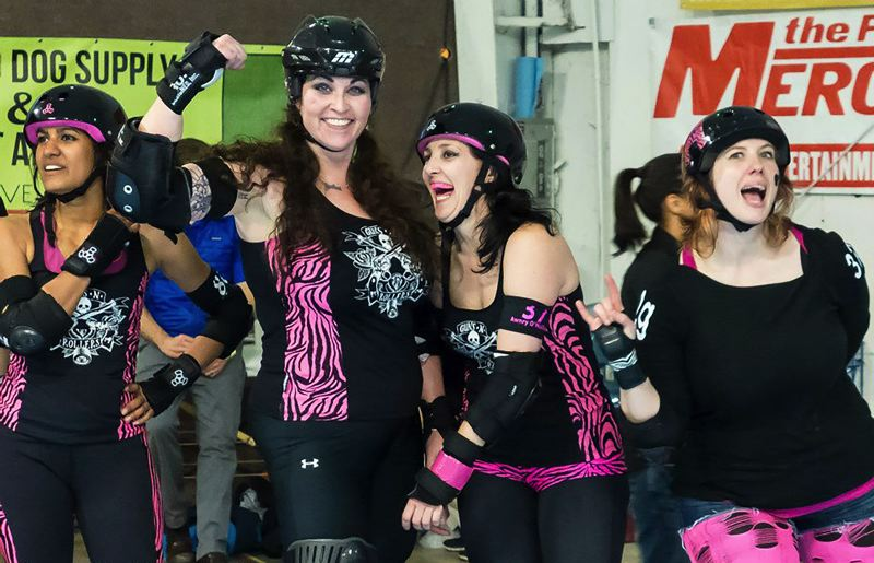 COURTESY: STEVEN J. PRICE - Maureen 'Tyger Bomb' Weber (left-center) is a veteran blocker for Portland's Rose City Rollers.