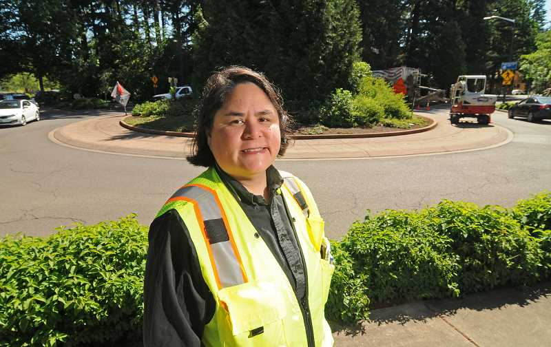 REVIEW PHOTO: VERN UYETAKE - Associate Engineer Crystal Shum says the roundabout at Carman Drive/Meadows Road/Quarry Road is her favorite intersection in Lake Oswego because it works the way roundabouts should work.