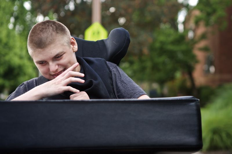 TRIBUNE PHOTO: JAIME VALDEZ - Nolan Nelson, 13, was affected by cytomegalovirus (CMV) when he was in the womb. CMV is much more common in Oregon than Zika and also causes microcephaly and developmental disabilities.