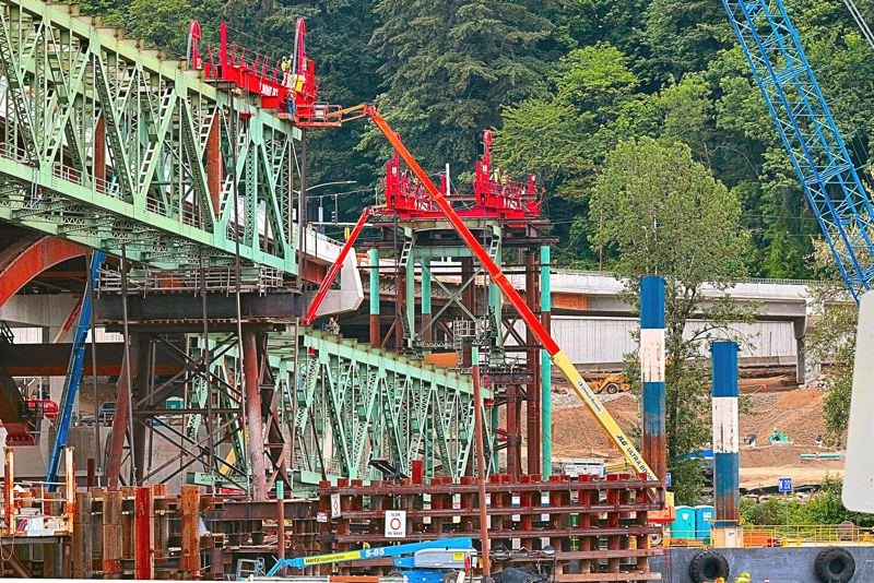 Piece by piece Old Sellwood Bridge cut down