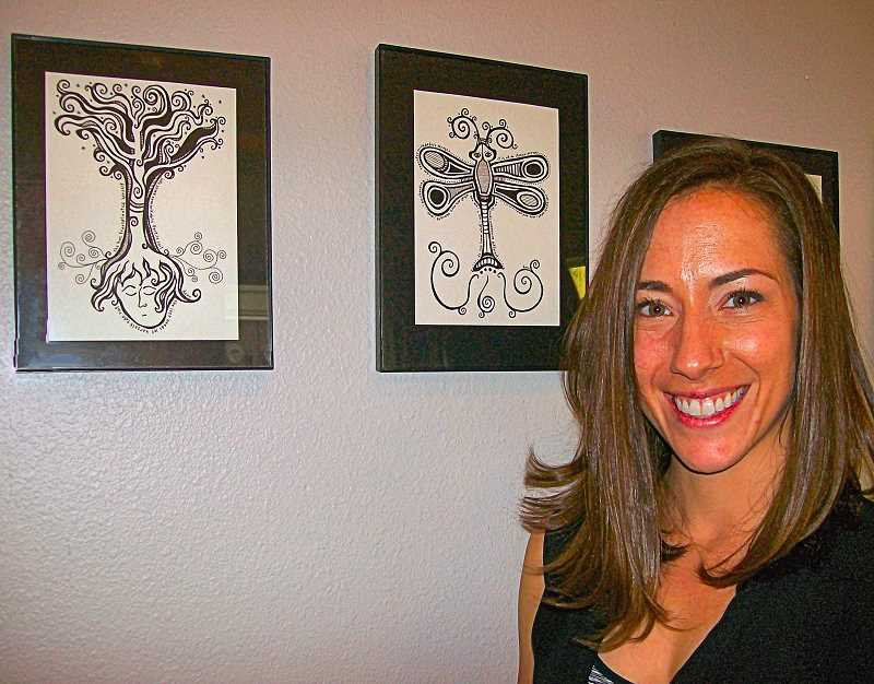 RITA A. LEONARD - Christie Gryphon is the new owner of Westmorelands Rose City Coffee Company, on S.E. Milwaukie Avenue - here shown with some of the local artwork on display.