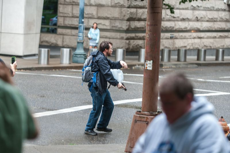 TRIBUNE PHOTO: DIEGO DIAZ - A man who pointed a gun in the direction of a Don't Shoot Portland rally and march downtown was taken into custody early Thursday evening, July 7. No one was injured in the incident.