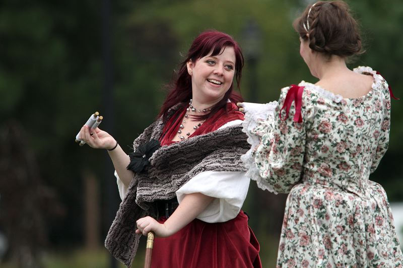 TIMES PHOTO: MILES VANCE - Lissie Lewis' Sebastian smiles during Original Practice Shakespeare Festival's production of 'The Tempest' at Schiffler Park on Sunday.