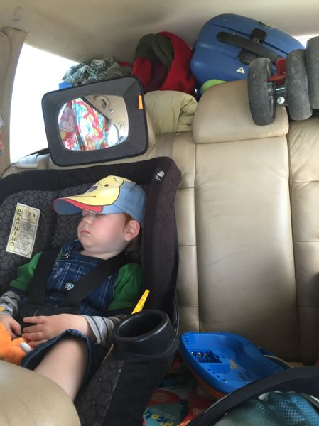 COURTESY: SARA BUBENIK - Baby Soren sleeps during his third cross-country trip -- all of the family's belongings piled in the back -- to try to get his mom a medical residency anywhere.