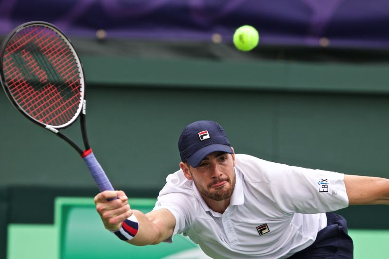 TIMES PHOTO: JAIME VALDEZ - Unitnd States singles player John Isner stretches for a return in his Sunday loss to Croatia's Maric Cilic in the Davis Cup quarterfinals at Tualatin Hills Tennis Center.