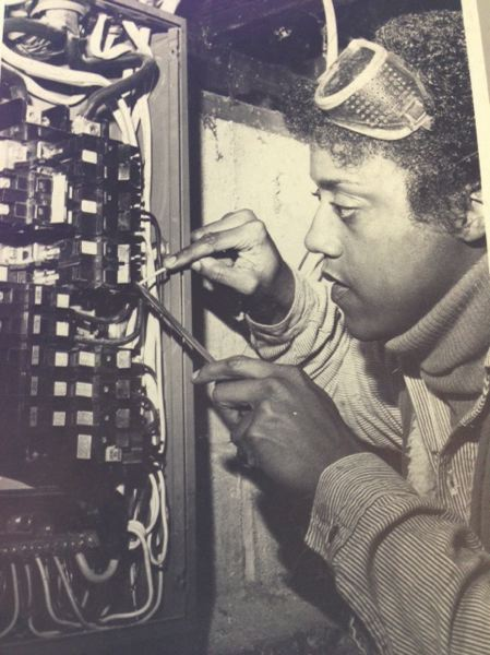 PHOTO COURTESY: IBEW 48 - In the late 1970's Donna Hammond, here working on a junction box, had to prove herself tough as well as capable to supervisors who had been ordered to wash her out.