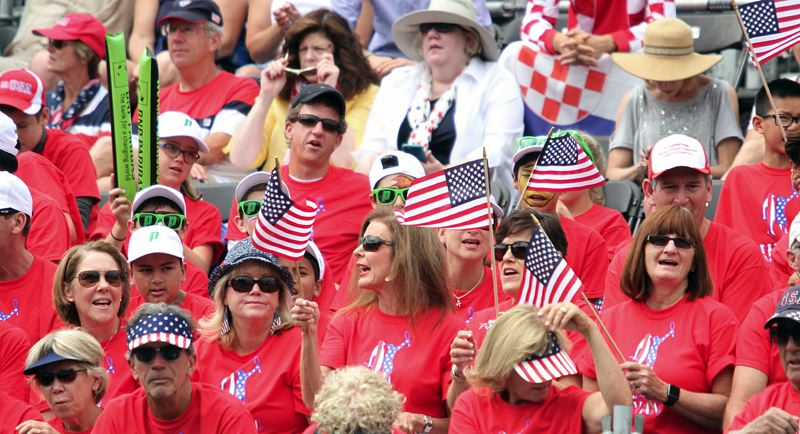 TIMES PHOTO: MILES VANCE - Fans of the United States team show their true colors at Tualatin Hills Tennis Center on the first day of the Davis Cup quarterfinals in Beaverton on Friday.