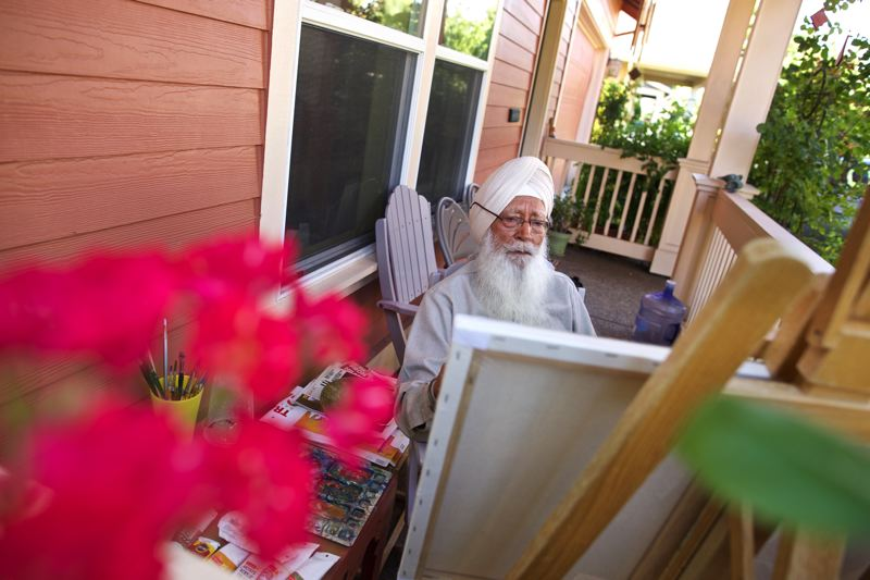 TIMES PHOTO: JAIME VALDEZ - Artist Ram Singh Bawa's studio is on the front porch of his home where he draws inspiration from the garden that surrounds him.