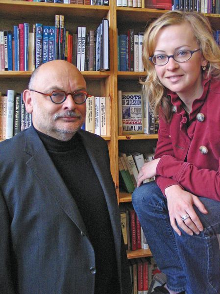 TRIBUNE PHOTO: LE BASKOW - Michael Powell with his daughter Emily, seen here in 2006. She says he's not sleeping too well at the thought of a 50x tax bill.