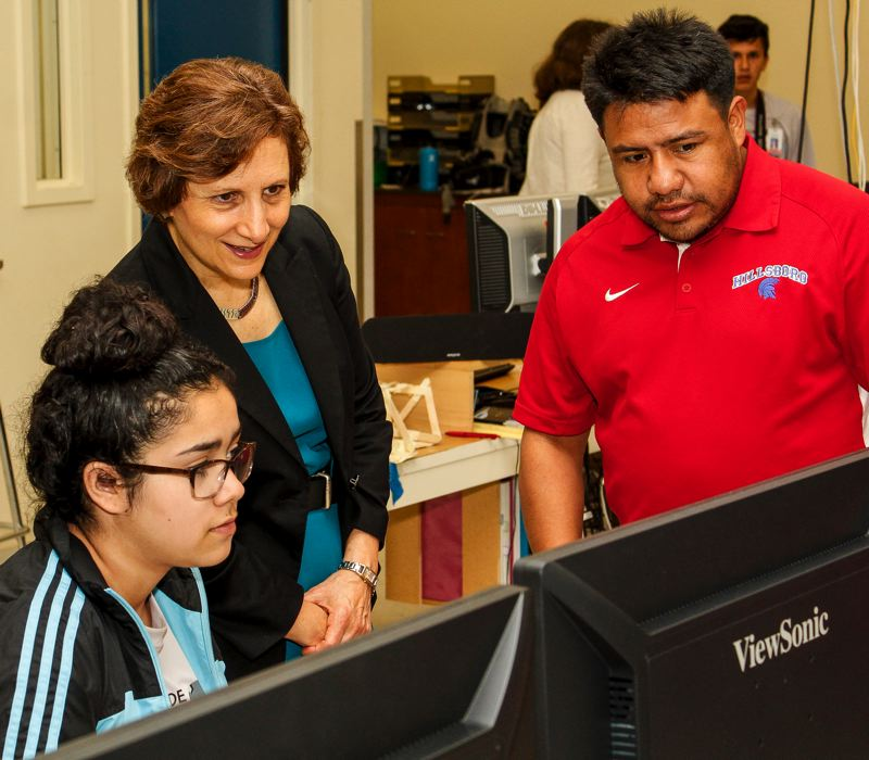 HILLSBORO TRIBUNE PHOTO: TRAVIS LOOSE - Along with Glencoe High School freshman Yasmin Sayago (left) and Program Tech Coach Miguel Cholula (right), Congresswoman Suzanne Bonamici (center) surveys the work done during the Si, Se Puede! Technology Camp at Hillsboro High School July 21.