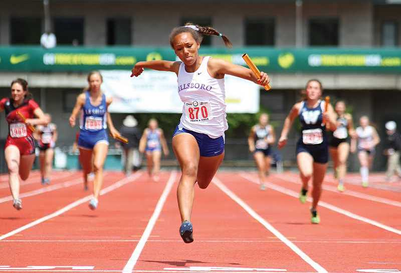 HILLSBORO TRIBUNE PHOTO: AMANDA MILES - Hilhi freshman Maddy Ellsworth hits the finish line in the 4x100-meter relay on Saturday at the Class 5A track and field state meet in Eugene last May. The photo won a second-place for best photography by the Oregon Newspaper Publisher's Association last week.