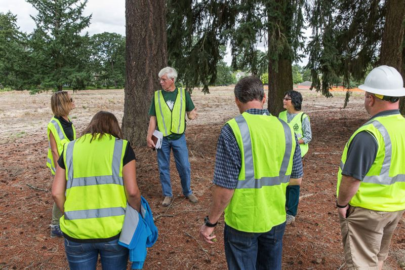 COURTESY PHOTO: RICK PAULSON - Patrick Dougherty meets with parks and construction officials at Orenco Woods Nature Park to check out possible sites to build a stickwork sculpture this coming spring.