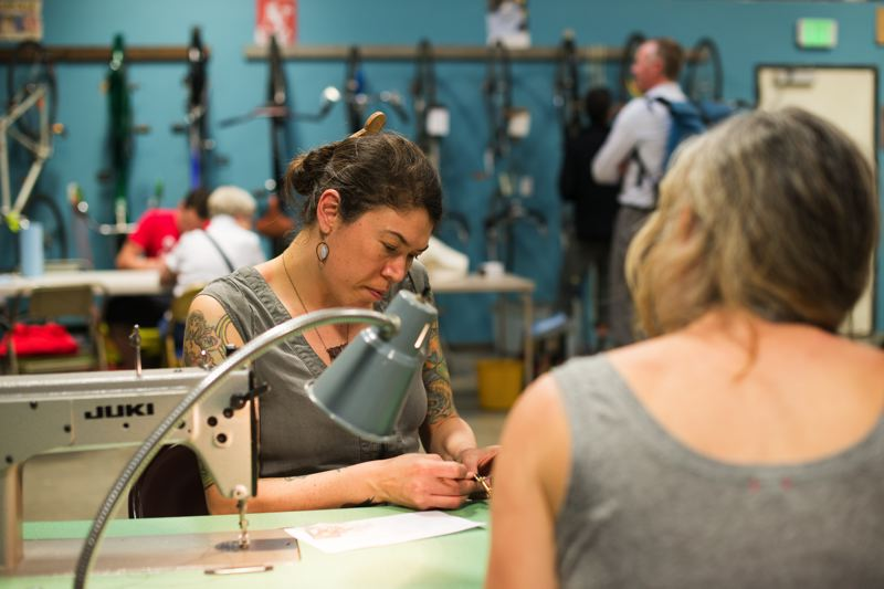 COURTESY: CITY OF PORTLAND BPS - Ellie Lum, a Repair PDX volunteer, helps neighbors learn to mend their own clothes and other items so they can be more resourceful at home.