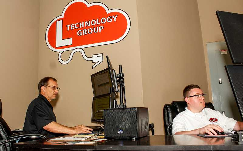 HILLSBORO TRIBUNE PHOTO: TRAVIS LOOSE - L Technology Groups Lennie Leger (left) and Nick Lockard (right) first met while working at a dog track in Florida. After starting his IT company in Beaverton, Lockard asked Leger to join him. They celebrated their grand opening July 23.