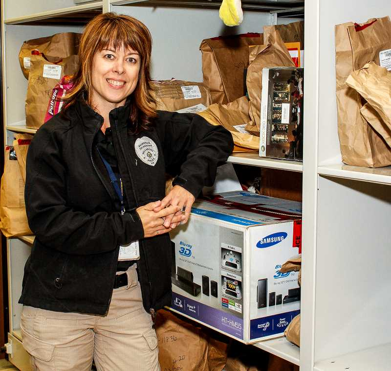 HILLSBORO TRIBUNE PHOTO: TRAVIS LOOSE - Hillsboro Police Department lead evidence technician Darci VandenHoek stands surrounded by a collection of evidence and lost and found items in the 10th Street precincts evidence room.