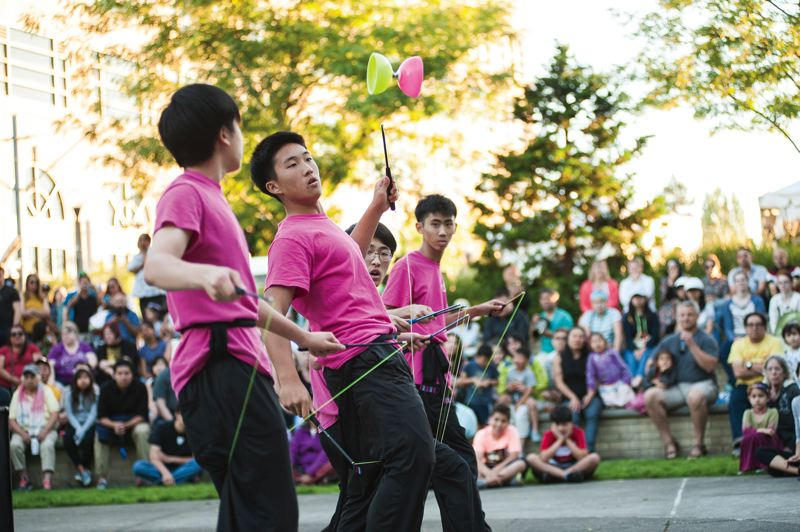 PHOTO FOR THE TIMES: ZACH KRAHMER - Chinese and Taiwanese members of the Formosa Association of Student Cultural Ambassadors perform a YoYo toss demonstration at Beaverton Night Market.