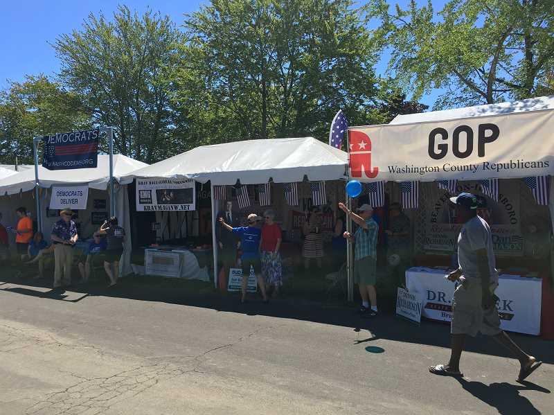 PMG PHOTO: RYAN LACKEY - The Washington County Fair has an ironic booth lineup this year. Democrats on the left, republicans on the right, and a martial arts gym in between to keep the two parties in check.