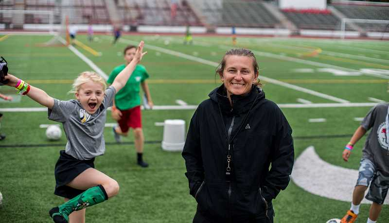 PAMPLIN MEDIA GROUP: CHASE ALLGOOD - Hillsboro native Tiffeny Milbrett inspires the next generation of female soccer players during her annual summer camp at Portland's Lincoln High.