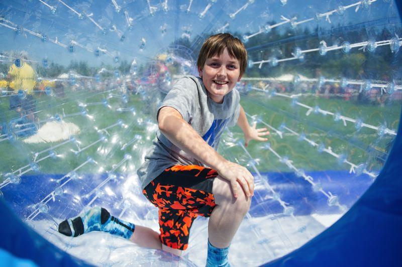 COURTESY TUALATIN HILLS PARK & RECREATION DISTRICT - This youngster took his turn at the Bubble Ball Raceway during Saturdays Party in the Park at the Howard M. Terpenning Recreation Complex in Beaverton.