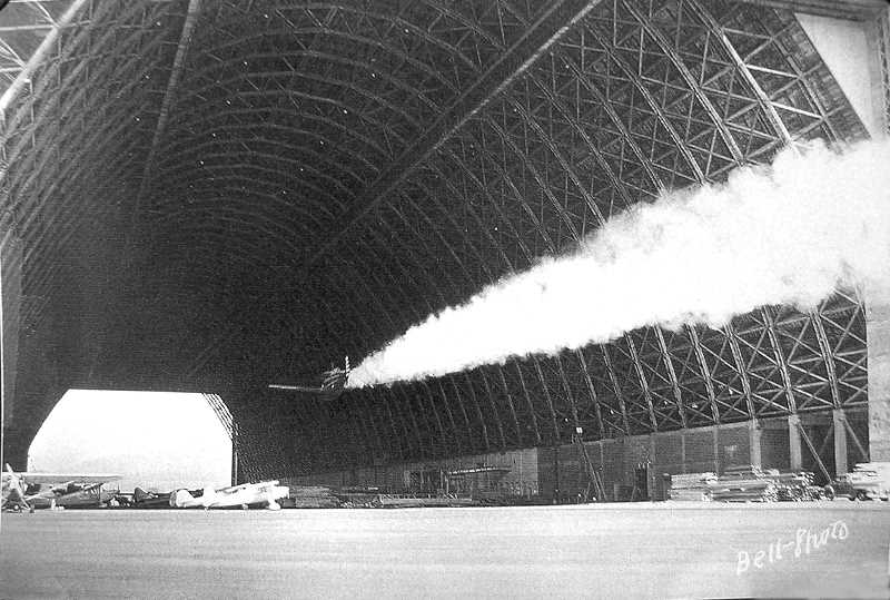 COURTESY PHOTO: MCCULLOUGH FAMILY - In this famous photo, Swede Ralston flies through a blimp hangar at the Tillamook Airport in 1950.