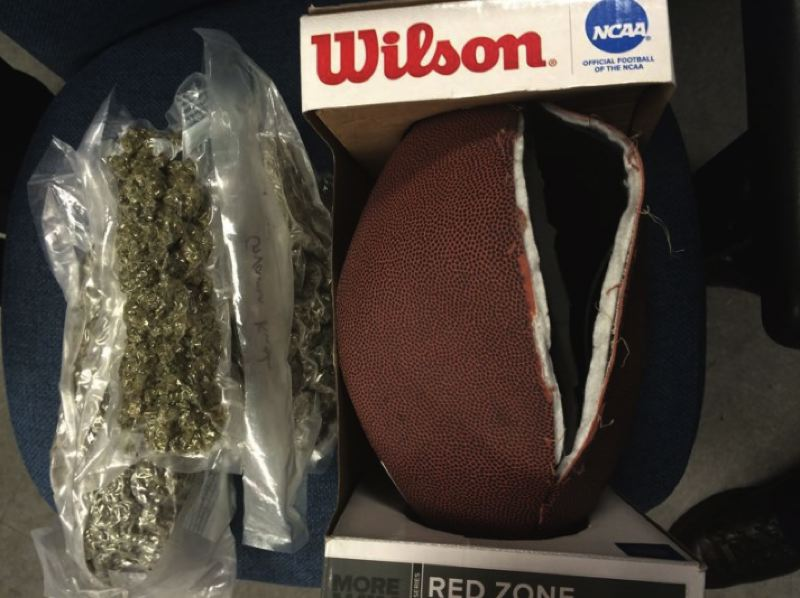COURTESY BEAVERTON POLICE - Police said they seized drugs and other illicit materials, some of which were reportedly concealed inside this football, during a traffic stop in Beaverton on Wednesday.