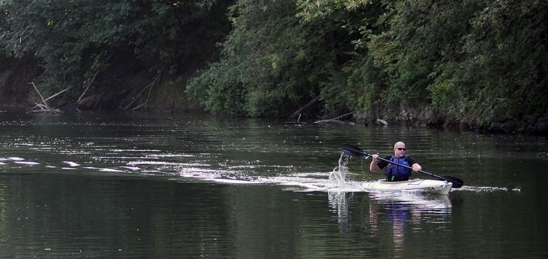 TIMES PHOTO: MILES VANCE - Tigard City Councilor John Goodhouse left the field far behind to win Saturday's Political Paddle Race on the Tualatin River.