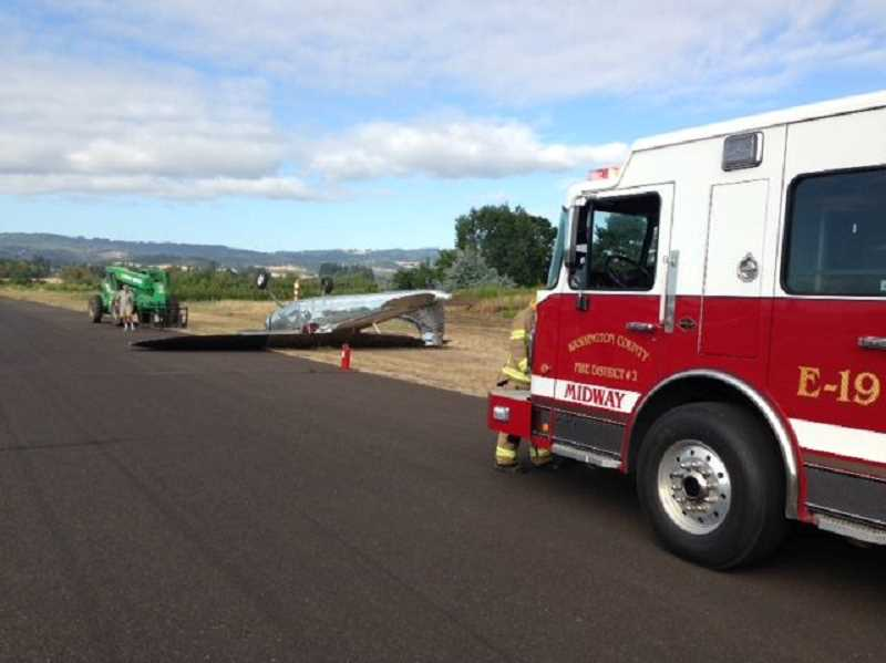 PHOTO COURTESY TVF&R - A Cessna flipped while landing at Twin Oaks Airpark on River Road on Saturday morning.