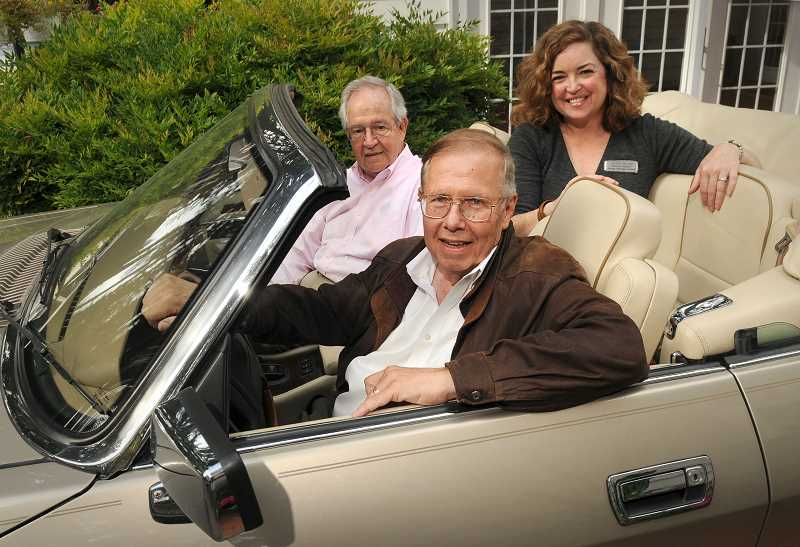 REVIEW PHOTO: VERN UYETAKE - John Baines (from left), Roger Rollins and Nancy Niland are the driving forces behind the 17th-annual Collector Car & Classic Boat Show, which is scheduled for Aug. 28.