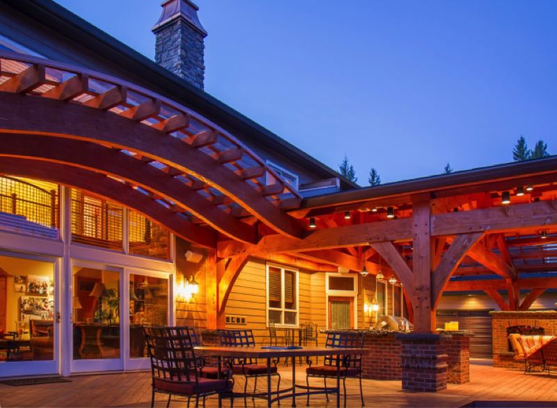 This traditional framed home added a beautiful outdoor area using beam trusses.