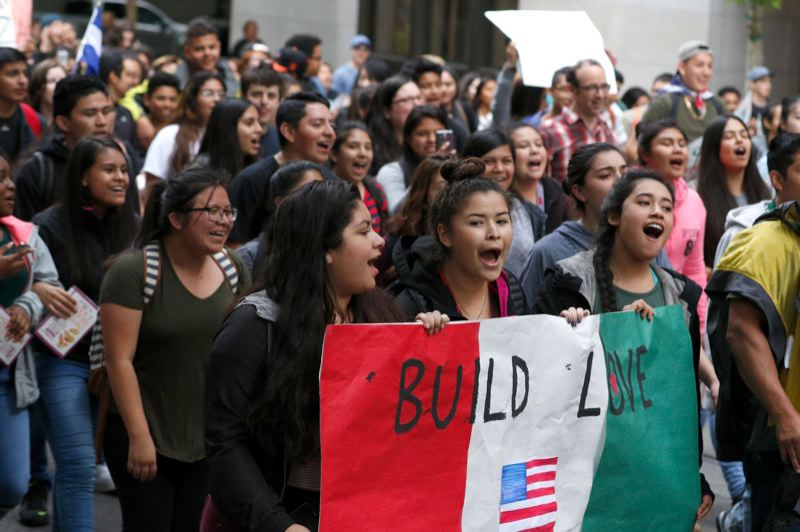 PORTLAND TRIBUNE: JONATHAN HOUSE - Students from Portland schools left class and rallied Monday, May 23, at City Hall to protest a 'build-a-wall' banner hung last week at Forest Grove High School.