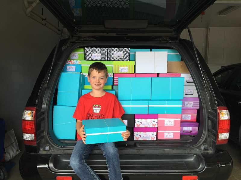 SUBMITTED PHOTO - Brayden Arsenault poses with a car full of his completed welcome boxes.