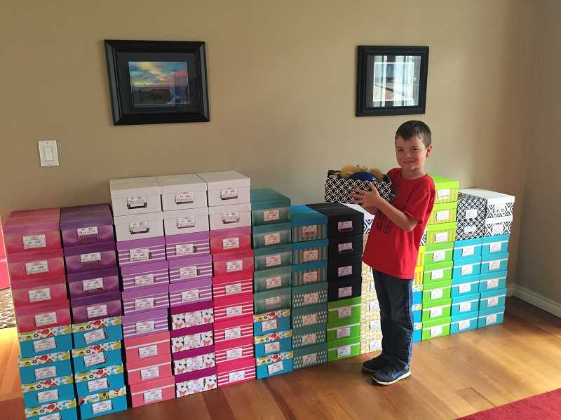 SUBMITTED PHOTO - Brayden Arsenault shows off one of his completed boxes. He donated 102 in total.