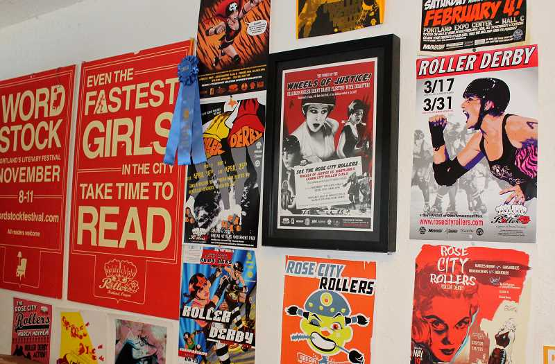 PAMPLIN MEDIA GROUP: PATRICK MALEE - Posters from the Rose City Rollers' early years line the walls of the team office in The Hangar at Oaks Amusement Park. Kim Stegeman says the game has evolved immensely since she founded RCR in 2004.
