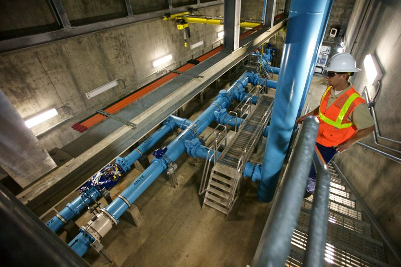 TIMES PHOTO: JAIME VALDEZ - Nick Augustus, Tualatin Valley Water Districts project manager, shows the valve vault in the pump station at Ridgewood View Park Reservoir.