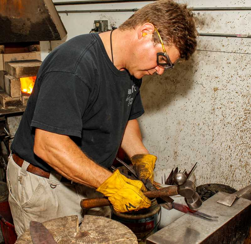HILLSBORO TRIBUNE PHOTOS: TRAVIS LOOSE - Murray Carter, a Hillsbor-based knifewmaker, has been refining steel and forging blades for nearly 30 years.